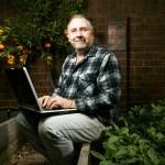 Gavin blogging in his garden
