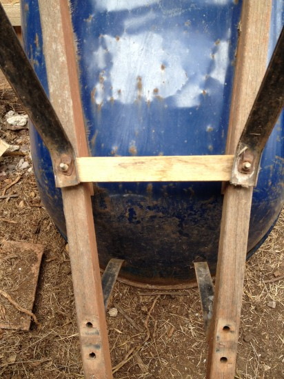 Repaired brace fitted back on wheelbarrow
